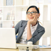 Portrait of a beautiful young businesswoman thinking. — Stock Photo