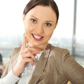 Portrait of a beautiful young businesswoman smiling at a meeting — Stock Photo