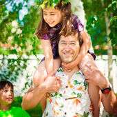 Artistic lifestyle photo of happy family: father piggyback his d — Stock Photo
