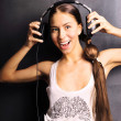 Club style woman with headphones listening to music — Stock Photo #6668378