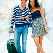 Young tourists . At modern international airport - 