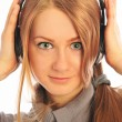 Young woman wearing headphones listening to the language course — Stock Photo
