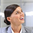 Closeup portrait of cute young business woman smiling — Stock Photo #6668730