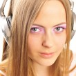 Beautiful woman with headphones, she is listening to the music — Stock Photo