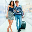 Young tourists . At modern international airport — Stock Photo #6668885
