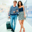 Young tourists . At modern international airport — Stock Photo #6668890