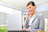 Beautiful business woman thinking about somethinking while worki — Stock Photo
