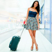 Portrait of young woman walking inside modern international airp — Stock Photo