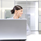 Young business woman on a laptop at her office. Looking Away — Stock Photo