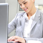 Young business woman on a laptop at her office. Working — Stock Photo