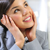 Closeup portrait of cute young business woman smiling and daydre — Stock Photo