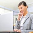 Beautiful business woman dreaming while working on computer at h — Stock Photo #6688204