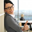 Closeup portrait of pretty cheerful business woman in an office — Stock Photo #6688212