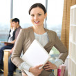 Closeup portrait of pretty cheerful business woman in an office — Stock Photo