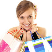 Portrait of lovely woman with shopping bags over white — Stock Photo