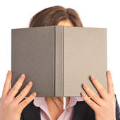 Young smiling student woman hiding under book. Over white backgr — Stock Photo
