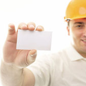 Closeup portrait of adult engineer man holding blank business ca — Stock Photo
