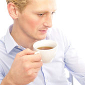 Successful business man is drinking a cup of coffee at his offic — Stock Photo