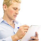 Closeup portrait of a cheerful young business man signing docume — Stock Photo