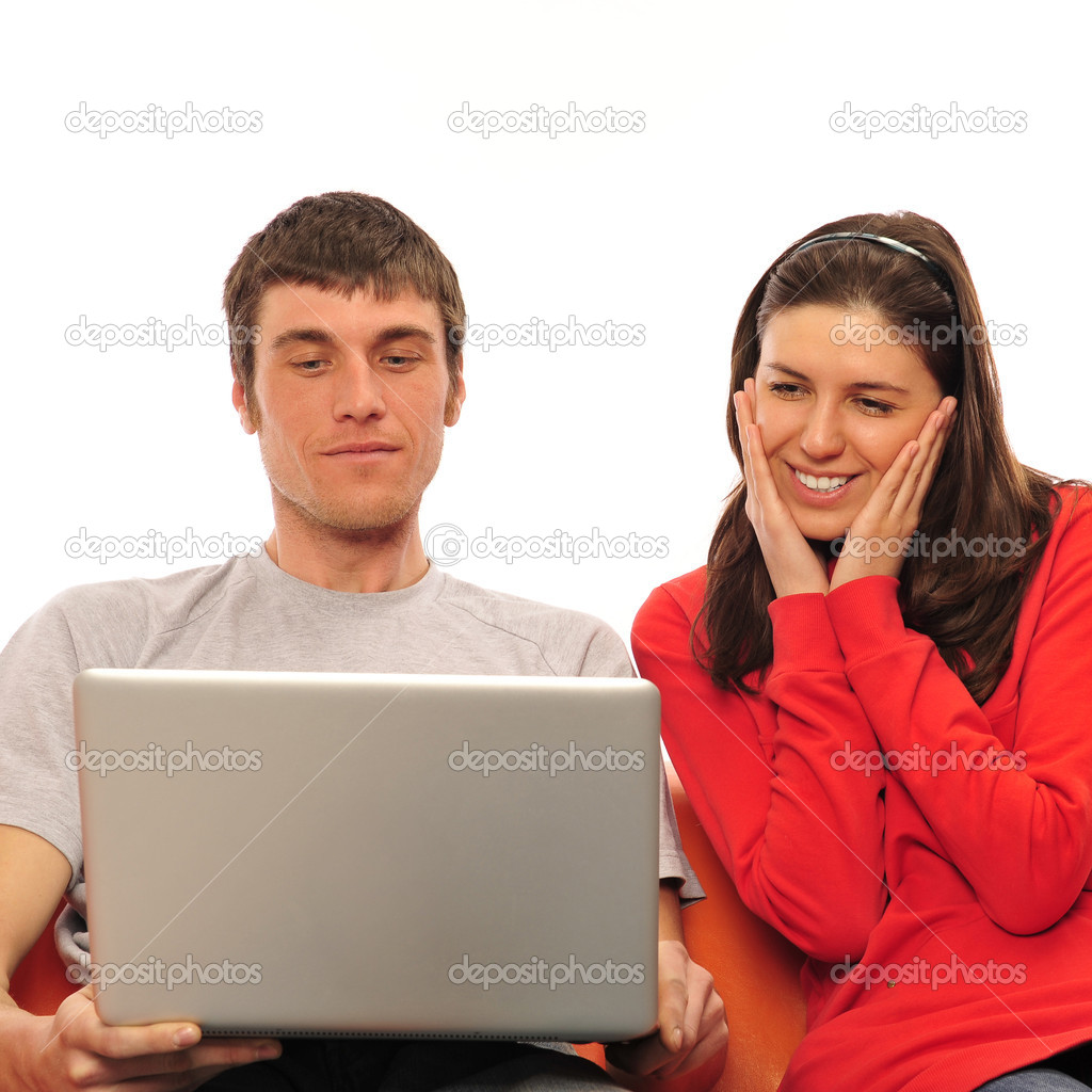 Young romantic couple sitting on their sofa and enjoying fast wireless connection  Stock Photo #6688131