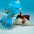 Stock Photo: Door gifts on blue