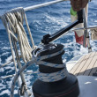 Italy, Sicily, Mediterranean Sea, cruising on a sailing boat, winch - Stock Photo