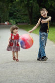 The brother and sister on walk in park — Stock Photo