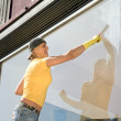 Women cleaning window — Stock Photo #5935510