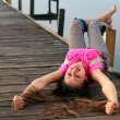 Relaxing young woman lying on the bridge — Stock Photo