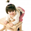 Little  girl on a chair — Stock Photo