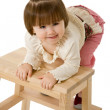 Little girl on a chair — Stock Photo #5938717