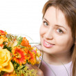 Young blond woman with flowers — Stock fotografie