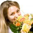 Young blond woman with flowers — Stock Photo