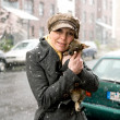 Woman is holding a little dog - Stock Photo