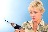 Woman with drill machine — Stock Photo