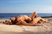 Girl lying on a beach — Stock Photo