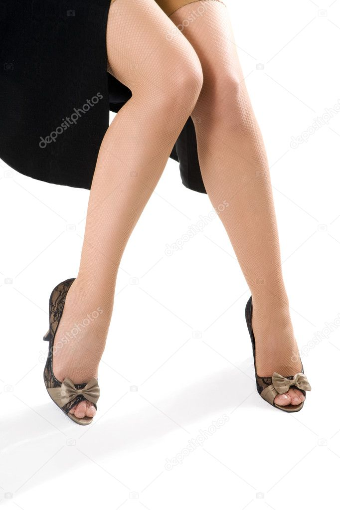 Sexy woman legs in black shoes isolated on white background — Stock Photo #5934936