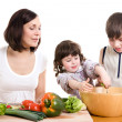 Mother and children cooking at the kitchen - Stock Photo