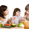 Mother and children cooking at the kitchen — Stock Photo #5940319