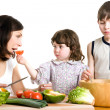 Mother and children cooking at the kitchen — Stock Photo #5940321