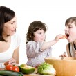Mother and children cooking at the kitchen — Stock Photo