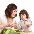 Mother and daughter cooking at the kitchen — Stock Photo #5940381