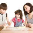Mother and children making a dough — Stock Photo #5940528