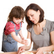 Mother and daughter making a dough — Stock Photo