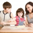 Mother and children making a dough — Stock Photo