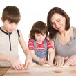 Mother and children making a dough — Stock Photo #5940658