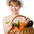 Girl holding a basket of fresh vegetables. — Stock Photo