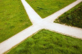 Crossroad in the country and green grass — Stock Photo