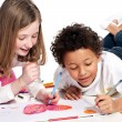 Interracial children drawing together — Stock Photo #6012379