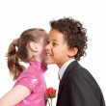 Cute little girl kissing a boy — Stock Photo